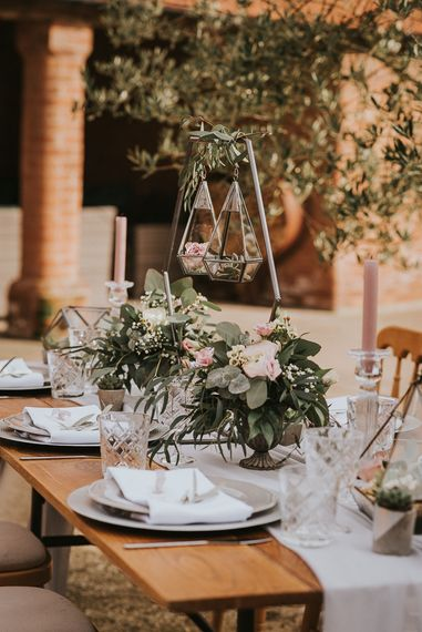 Table Centrepiece of Hanging Terrariums on a Geometric Hexagonal Stand and Romantic Floral Arrangements