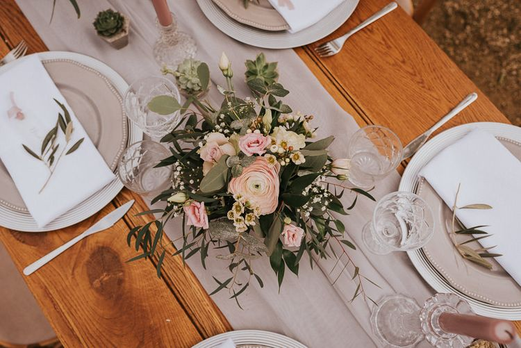 Romantic Blush Pink and Foliage Floral Centrepiece on a Grey Table Runner