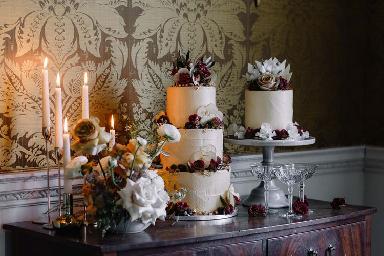 Wedding Cake Table on Vintage Dresser with Taper Candles and Three Tier Wedding Cake