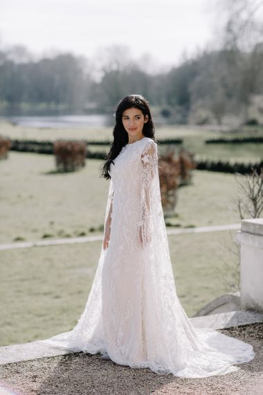 Bride in Intricate Lace and Applique Wedding Dress with Long Bell Sleeves