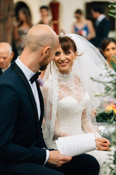 Wedding Ceremony | Bride in Bespoke Lace Wedding Dress | Groom in YSL Black Tie Suit | Colourful, Sophisticated,  Outdoor Wedding at Is Morus Relais in Southern Sardinia, Italy |  Greg Funnell Photography