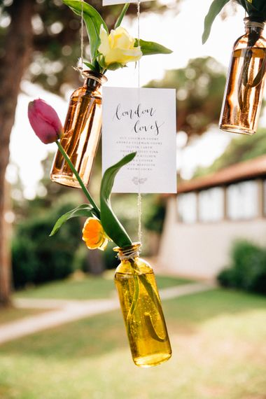 Hanging Bottles & Flower Stems Wedding Decor | Colourful, Sophisticated,  Outdoor Wedding at Is Morus Relais in Southern Sardinia, Italy |  Greg Funnell Photography