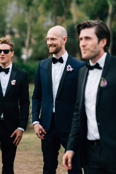 Groomsmen in Black Tie Suits | Colourful, Sophisticated,  Outdoor Wedding at Is Morus Relais in Southern Sardinia, Italy |  Greg Funnell PhotographyColourful, Sophisticated,  Outdoor Wedding at Is Morus Relais in Southern Sardinia, Italy |  Greg Funnell Photography