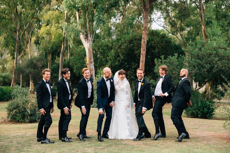 Groomsmen in Black Tie | Bride in Bespoke Lace Wedding Dress | Colourful, Sophisticated,  Outdoor Wedding at Is Morus Relais in Southern Sardinia, Italy |  Greg Funnell Photography