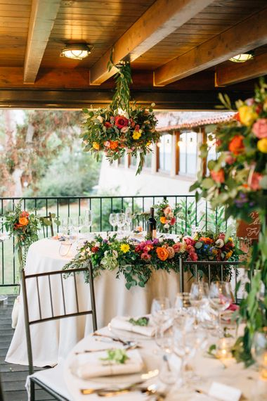 Veranda Wedding Reception with Floral Installations | Colourful, Sophisticated,  Outdoor Wedding at Is Morus Relais in Southern Sardinia, Italy |  Greg Funnell Photography