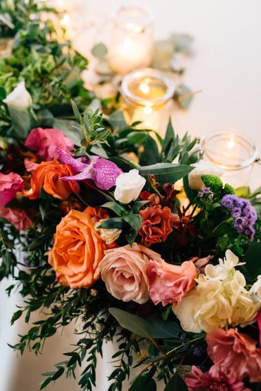 Colourful Floral Garland | Colourful, Sophisticated,  Outdoor Wedding at Is Morus Relais in Southern Sardinia, Italy |  Greg Funnell Photography
