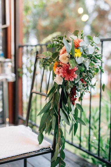Floral Chair Back Decor | Colourful, Sophisticated,  Outdoor Wedding at Is Morus Relais in Southern Sardinia, Italy |  Greg Funnell Photography