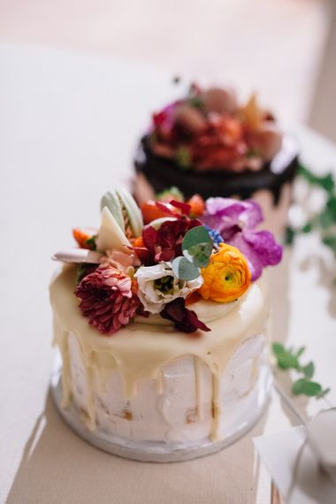Semi Naked Cake with Drip Icing and Flower Topper | Bride in Bespoke Lace Wedding Dress | Groom in YSL Black Tie Suit | Colourful, Sophisticated,  Outdoor Wedding at Is Morus Relais in Southern Sardinia, Italy |  Greg Funnell Photography
