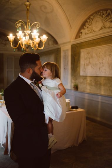 Groom in Black Suit & Flower Girl Daughter | Green & White Bohemian Wedding in the Rain at Castello di San Sebastiano da Po, Italy | Margherita Calati Photography | Second Shooter Carlo Vittorio