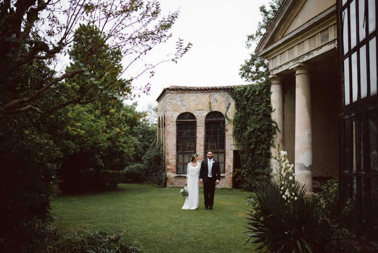 Bride in Laure De Sagazan Gown | Groom in Black Suit | Green & White Bohemian Wedding in the Rain at Castello di San Sebastiano da Po, Italy | Margherita Calati Photography | Second Shooter Carlo Vittorio