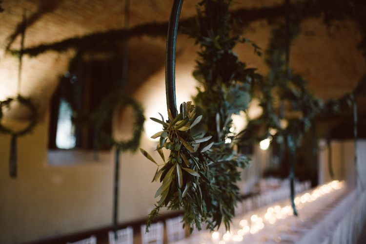 Greenery Hanging Hoops & Candle Light Wedding Reception Decor | Green & White Bohemian Wedding in the Rain at Castello di San Sebastiano da Po, Italy | Margherita Calati Photography | Second Shooter Carlo Vittorio