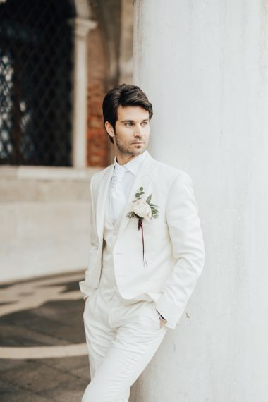 Groom in Ivory Three piece Suit with White Shirt and Cravat