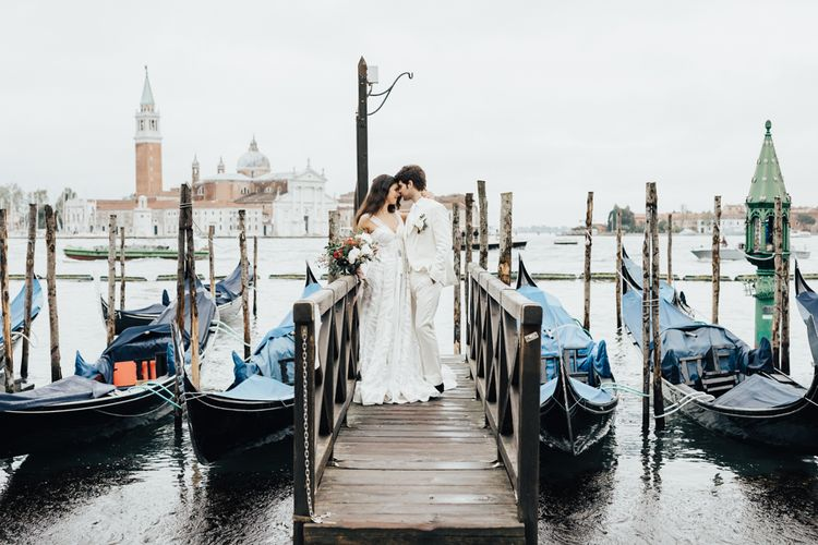 Bride and Groom in All White Standing on a Venice Dock for Elopement Wedding