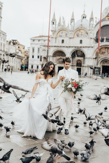 Bride and Groom Dancing Amongst the Pigeons in Venice Square for Elopement Wedding