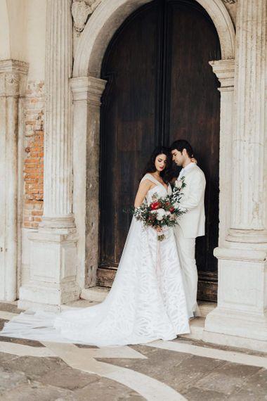 Bride in Halterneck Wedding Dress  and Groom in White Wedding Suit for Venice Elopement