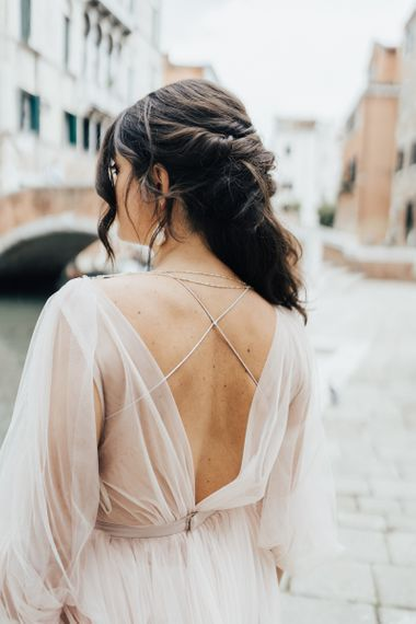 Bride in Tulle Wedding Dress with Delicate Strap Detail
