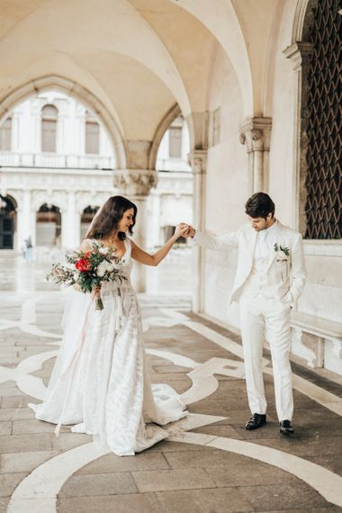 Groom in All White Wedding Suit and Bride in Applique Wedding Dress with Straps