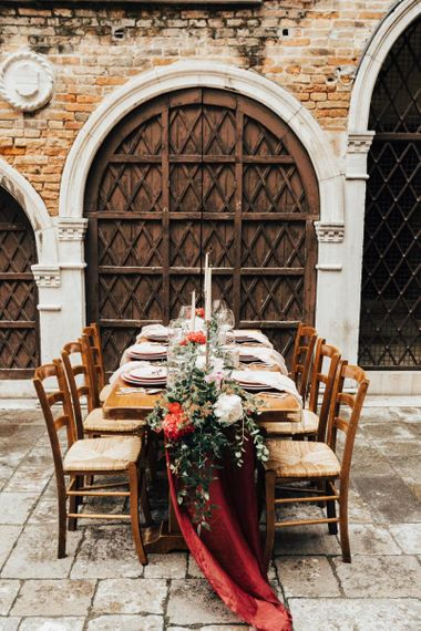 Outdoor Tablescape with Floral Centrepiece of peonies, Foliage and Candles