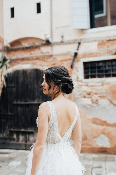 Bride in Feather Wedding Dress with Sleek Bridal Updo
