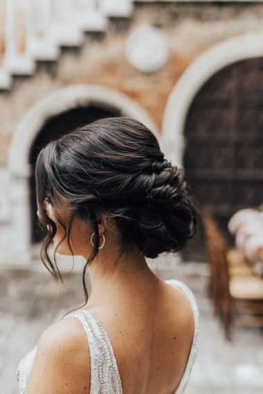 Chic Bridal Updo with Twisted Bun and Loose Hair Trestles