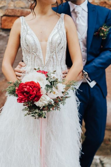 Bride Holding a Red and White Peony Bridal Bouquet with Foliage