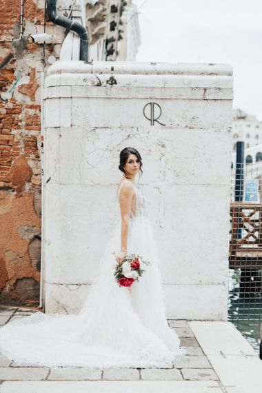 Bride in Romantic Wedding Dress with Embellished Top and Feather Skirt