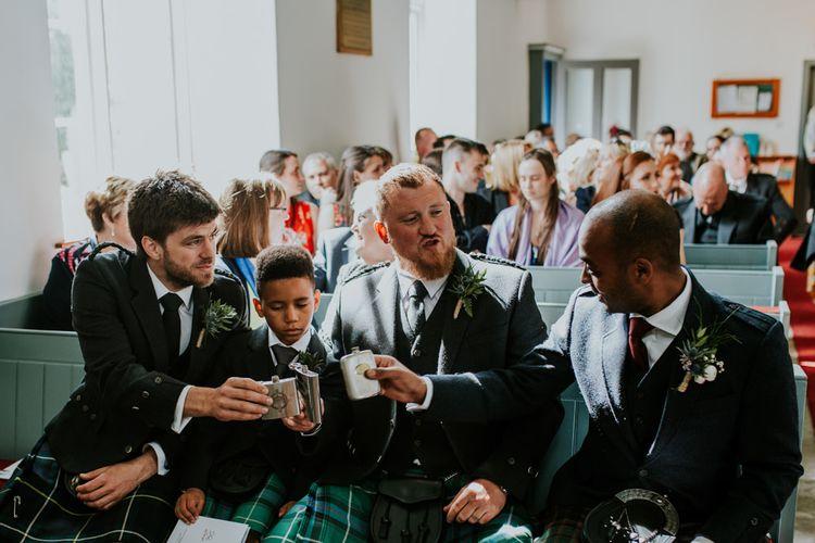 Groom and Groomsmen toast the ceremony
