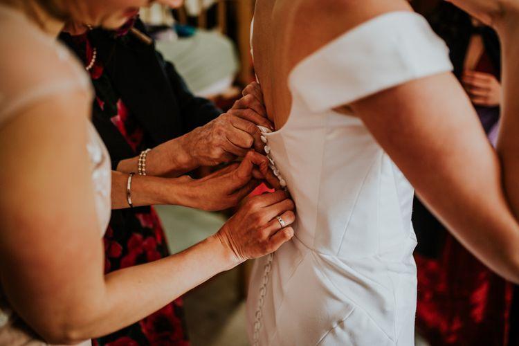 Bride gets her vegan fitted wedding dress on