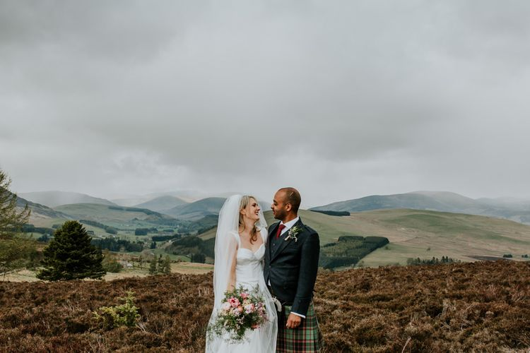 Scottish wedding with marquee decorated in hanging flowers