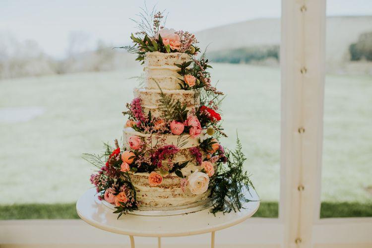 Semi-naked floral decorated wedding cake