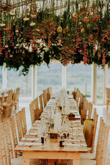 Amazing hanging flower decor in marquee reception