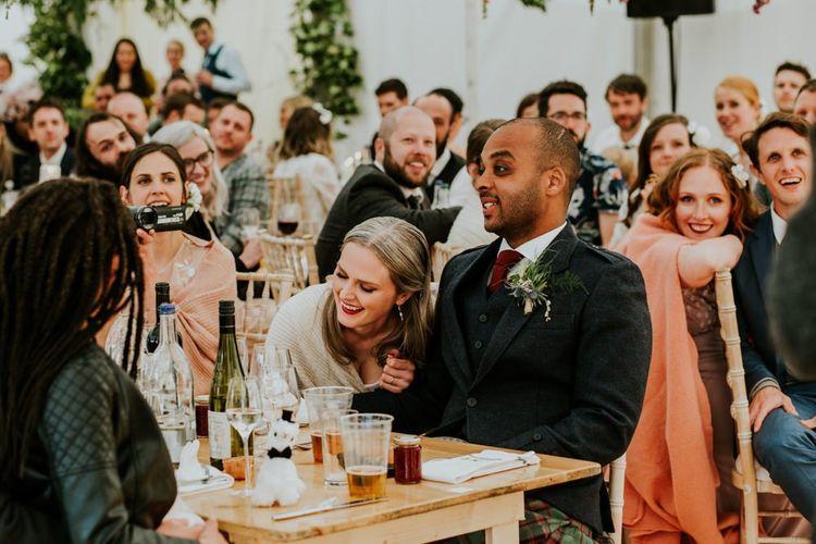 Bride and groom enjoy the wedding speeches