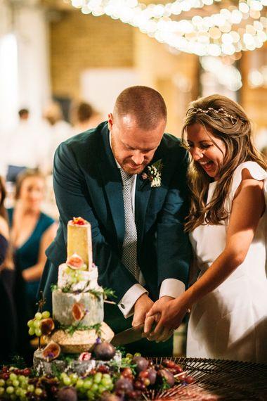 Cutting the Cheese Tower Wedding Cake | Bride in Belle & Bunty Wedding Dress | Islington Town Hall & Brixton East City Wedding | Joanna Bongard Photography
