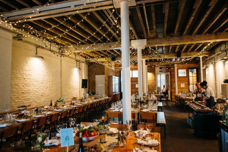Fairy Light Reception Venue Decor | Belle & Bunty Wedding Dress for an Islington Town Hall & Brixton East City Wedding | Joanna Bongard Photography