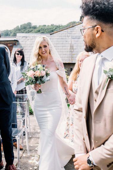 Bride Getting Emotional Walking Down the Aisle Towards Her Groom