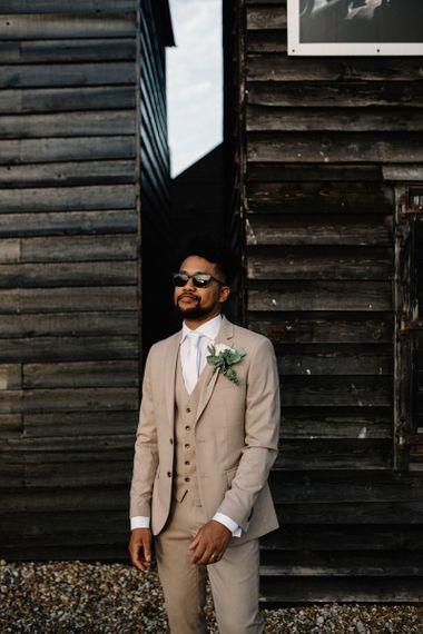 Stylish Groom in Beige Moss Bros. Three-Piece Wedding Suit