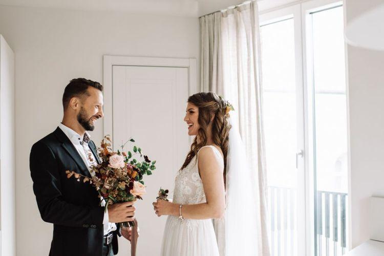 First Look with Bride in Fay Katya Katya Wedding Dress and Groom in Black Suit