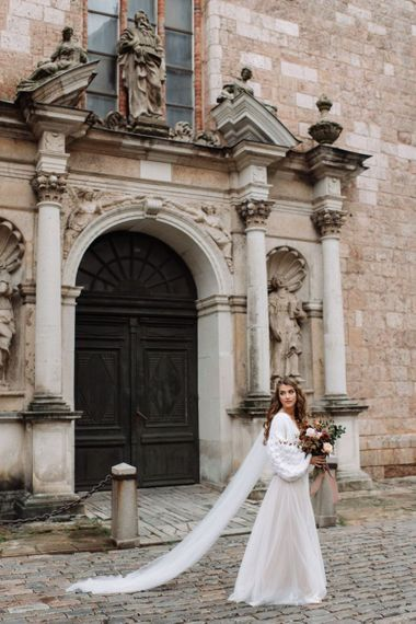 Bride in Fay Katya Katya Wedding Dress with Chiffon Skirt, Knitted Coverup and Cathedral Length Veil