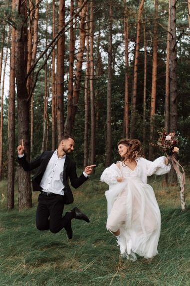 Bride and Groom Skipping in the Woods