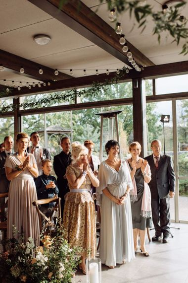 Stylish Wedding Guests Clapping During the Wedding Ceremony