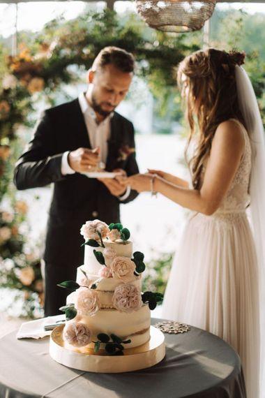 Semi Naked Wedding Cake Decorated with Fresh Flowers