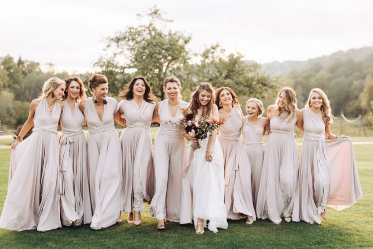 Bridal Party Portrait with Bridesmaids in Oyster Wrap Dresses and Bride in Fay Katya Katya Wedding Dress