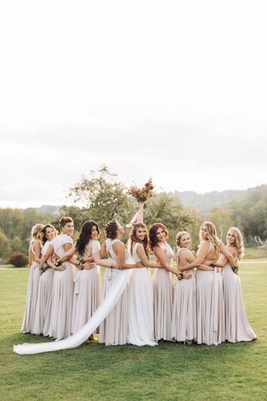 Bridal Party Portrait with Bridesmaids in Oyster Multiway Dresses and Bride in Fay Katya Katya Wedding Dress