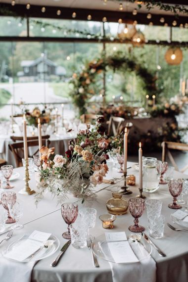 Blush Pink Wedding Reception Table Decor with Taper Candles and Floral Arrangement