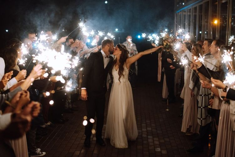 Sparkler Moment with Bride in Fay Katya Katya Wedding Dress and Groom in Black Suit Kissing