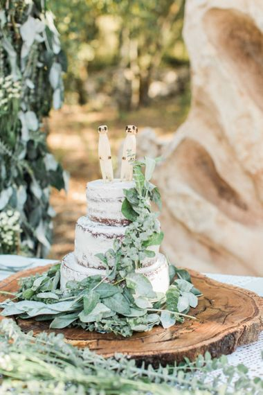 Semi Naked Wedding Cake on Wooden Slice Cake Stand with MeerKat Wedding Cake Toppers