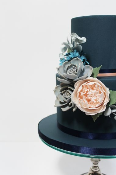 Navy Iced Tiered Cake with Flowers by Iced Delights