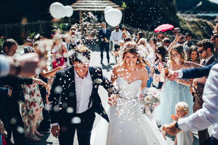 Wedding Confetti Exit by Toby Lowe Photography