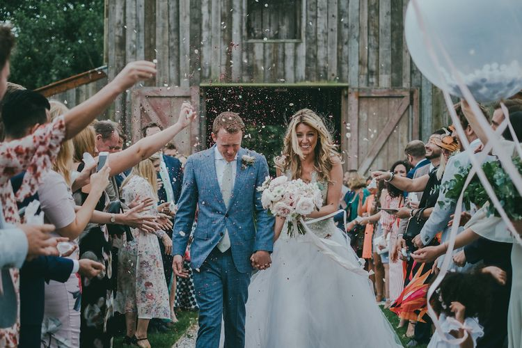 Barn Wedding Confetti Exit Image By Ross Talling Photography