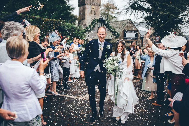 Ribbon Tied Bouquet Confetti Exit Image by Toby Lowe Photography